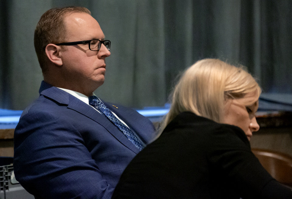 Photo -  Oklahoma City police Sgt. Keith Patrick Sweeney, left, sits in his trial in the courtroom of District Judge Natalie Mai at the Oklahoma County Courthouse on Thursday, Oct. 24, 2019 in Oklahoma City. [Chris Landsberger/The Oklahoman]