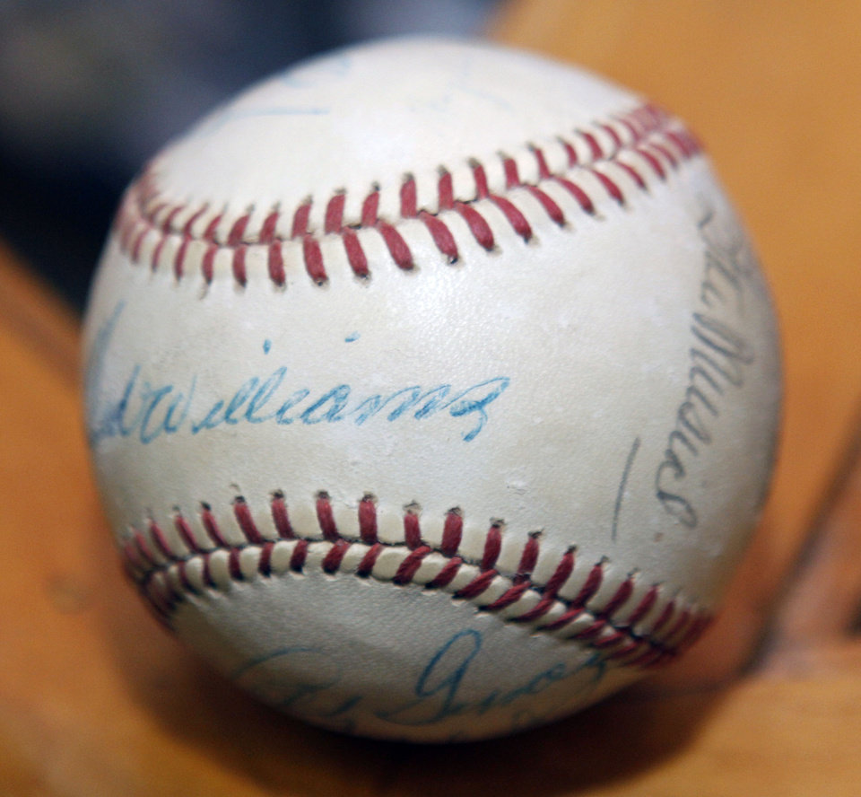 Photo - BASEBALL COLLECTION: TED WILLIAMS: This is one of the items in a collection of autographed baseballs on display at the Oklahoma Sports Hall of Fame in Guthrie, OK, Thursday, April 11, 2013,  By Paul Hellstern, The Oklahoman