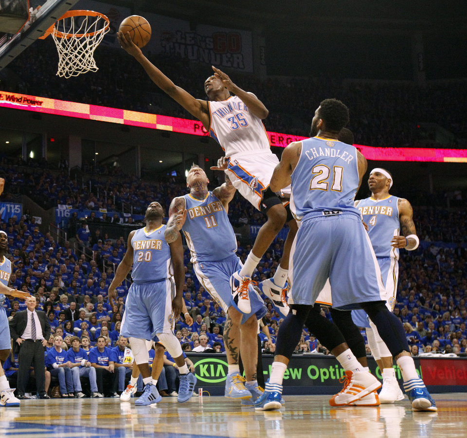 Photo - Oklahoma City's Kevin Durant (35) goes to the basket between Denver's Raymond Felton (20), Chris Andersen (11), Kenyon Martin (4), and Wilson Chandler (21) during the NBA basketball game between the Denver Nuggets and the Oklahoma City Thunder in the first round of the NBA playoffs at the Oklahoma City Arena, Sunday, April 17, 2011. Photo by Bryan Terry, The Oklahoman