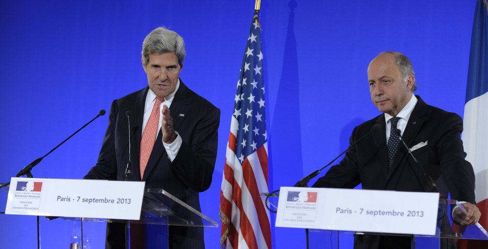 Photo - Secretary of State John Kerry speaks at joint press conference with French Foreign Minister Laurent Fabius, right, at the Ministry of Foreign Affairs in Paris, Saturday, Sept. 7, 2013. European foreign ministers on Saturday endorsed a