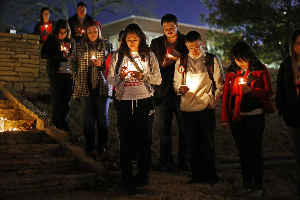 A crowd prays during a vigil put on Tuesday by DREAM Act Norman at the University of Oklahoma. Photos by Bryan Terry, The Oklahoman