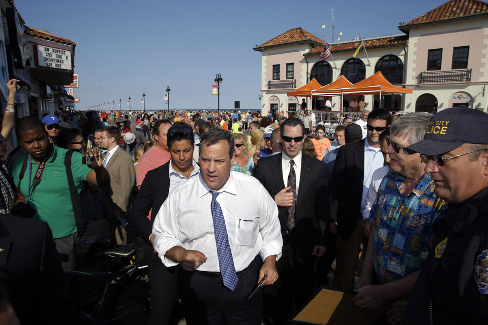Photo - FILE - In this Thursday, Aug. 14, 2014, file photo, New Jersey Gov. Chris Christie walks along a boardwalk after a town hall meeting in Ocean City, N.J. Christie is heading to Mexico officially for a trade mission typical of any governor. But Christie is a potential GOP presidential candidate with little foreign policy expertise, a lot of swagger and much to learn about international diplomacy. He is one of several potential White House hopefuls burnishing their foreign policy credentials for any possible general election matchup against Democrat Hillary Rodham Clinton, a former secretary of state. (AP Photo/Mel Evans, File)