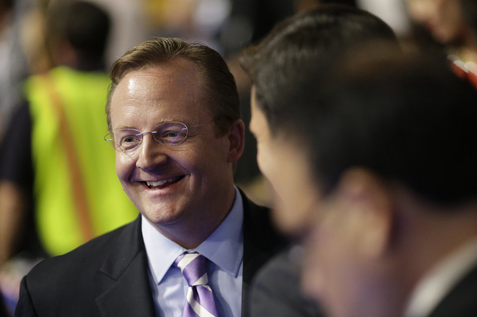 Photo - Former White House Press Secretary Robert Gibbs is seen on the floor at the Democratic National Convention in Charlotte, N.C., on Tuesday, Sept. 4, 2012. (AP Photo/David Goldman)  ORG XMIT: DNC777
