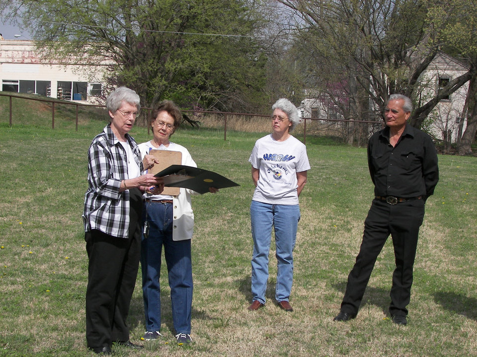 At the groundbreaking ceremony for the Harrah Historical Society\'s new museum, Ruth Shaw, society Secretary, reads the House of Representatives congratulatory citation to President Jeanne Ann Weller, while Linda Parrish, Vice President, and Hans Willemse, Museum Construction Team Chairperson, look on. Community Photo By: Karen Erbin Submitted By: linda, harrah