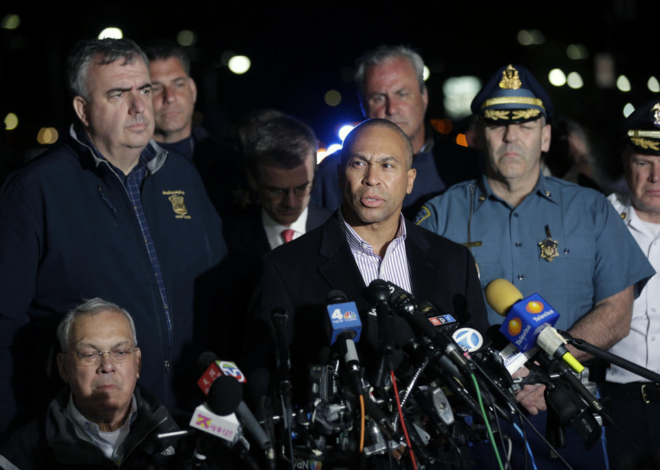 Massachusetts Governor Deval Patrick, at podium, speaks during a news conference, after the arrest of a suspect of the Boston Marathon bombings in Watertown, Mass., Friday, April 19, 2013. A 19-year-old college student wanted in the Boston Marathon bombings was taken into custody Friday evening after a manhunt that left the city virtually paralyzed and his older brother and accomplice dead.  (AP Photo/Matt Rourke) ORG XMIT: MAMR152