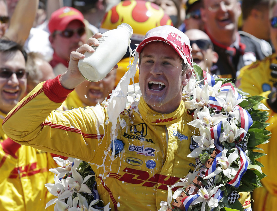Photo - Ryan Hunter-Reay celebrates winning the Indianapolis 500 IndyCar auto race at the Indianapolis Motor Speedway in Indianapolis, Sunday, May 25, 2014. (AP Photo/AJ Mast)