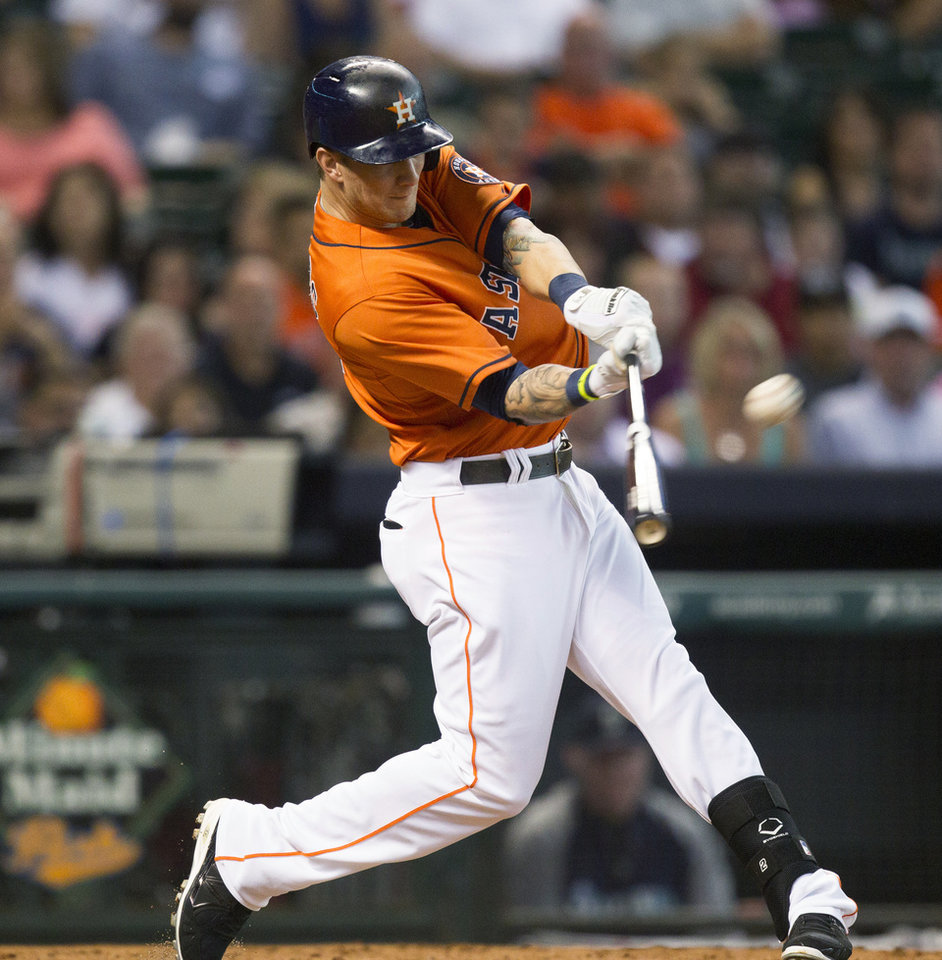 Houston Astros' Brandon Barnes hits a home run to left field in the second inning against the Seattle Mariners during a baseball game Friday, July 19, 2013, in Houston. (AP Photo/Bob Levey)