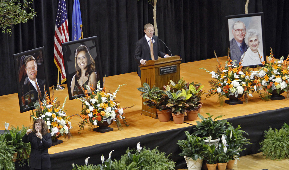 Photo - Oklahoma State athletic director Mike Holder speaks during the memorial service for Oklahoma State head basketball coach Kurt Budke and assistant coach Miranda Serna at Gallagher-Iba Arena on Monday, Nov. 21, 2011 in Stillwater, Okla. The two were killed in a plane crash along with former state senator Olin Branstetter and his wife Paula while on a recruiting trip in central Arkansas last Thursday. Photo by Chris Landsberger, The Oklahoman