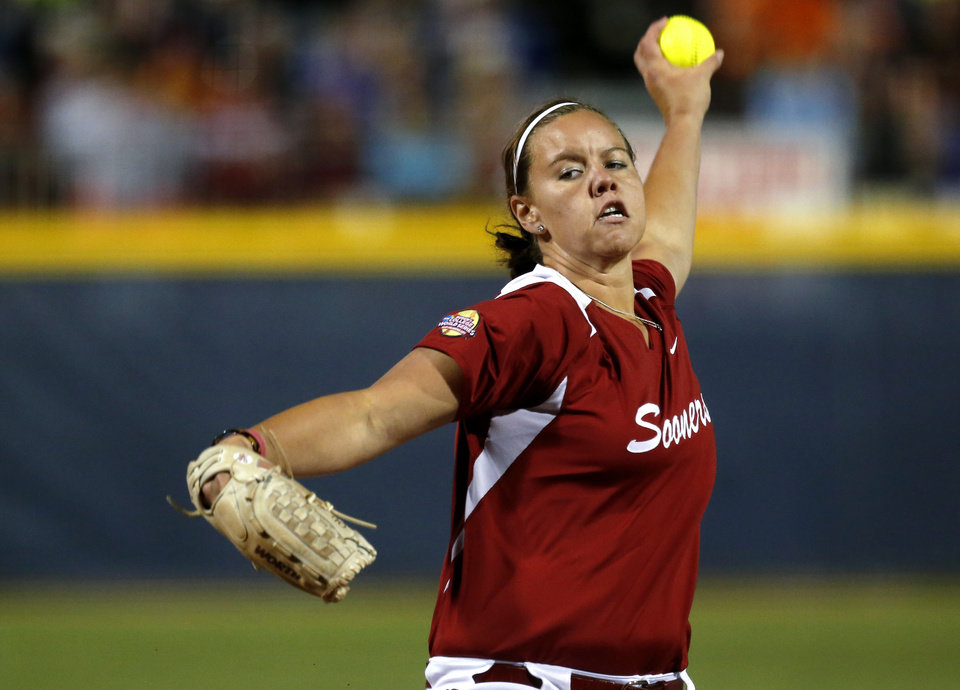Photo - Oklahoma's Keilani Ricketts pitches against Washington during their Women's College World Series softball game at ASA Hall of Fame Stadium in Oklahoma City, Sunday, June, 2, 2013. Photo by Sarah Phipps, The Oklahoman Download