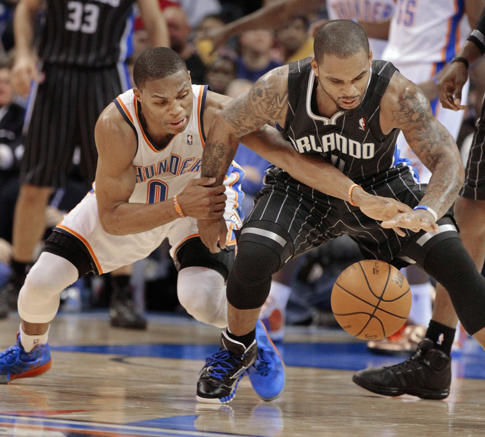 Oklahoma City Thunder's Russell Westbrook (0) tries to steal the ball from Orlando Magic's Jameer Nelson (14) in the second half as the Oklahoma City Thunder defeat the Orlando Magic 97-89 in NBA basketball at the Chesapeake Energy Arena on Sunday, Dec. 25, 2011, in Oklahoma City, Okla.  Photo by Steve Sisney, The Oklahoman
