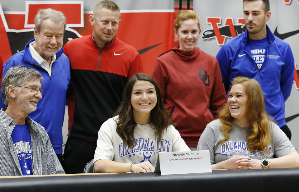 Photo - Nevaeh Sheriff smiles after signing letter to play at Oklahoma City University during Signing Day event at Westmoore High School on Wednesday, Feb. 6, 2019.  Photo by Jim Beckel, The Oklahoman.