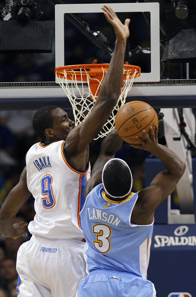 Photo - Oklahoma City's Serge Ibaka (9) tries to block a shot by Denver's Ty Lawson (3) during the first round NBA playoff game between the Oklahoma City Thunder and the Denver Nuggets on Sunday, April 17, 2011, in Oklahoma City, Okla. Photo by Chris Landsberger, The Oklahoman