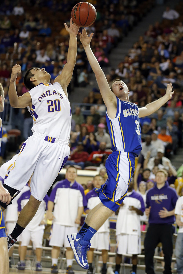 Weleetka's Jeremiah Winney and Glencoe's Kagen Castlebury fight for a rebound during the Class A boys state championship between Glencoe and Weleetka  at the State Fair Arena.,  Saturday, March 2, 2013. Photo by Sarah Phipps, The Oklahoman