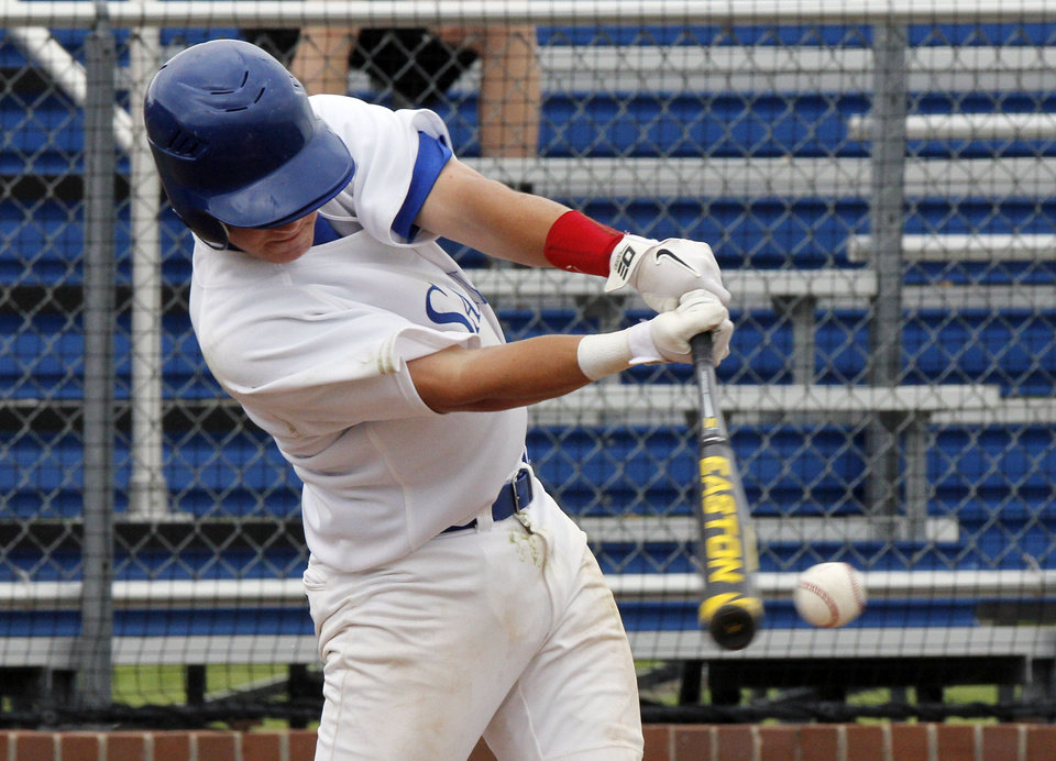 Photo - OCS' Callen Crockett hits a foul during the Class 3A state baseball tournament between Verdigris and Oklahoma Christian at Deer Creek High School in Oklahoma City, OK, Thursday, May 9, 2013,  By Paul Hellstern, The Oklahoman