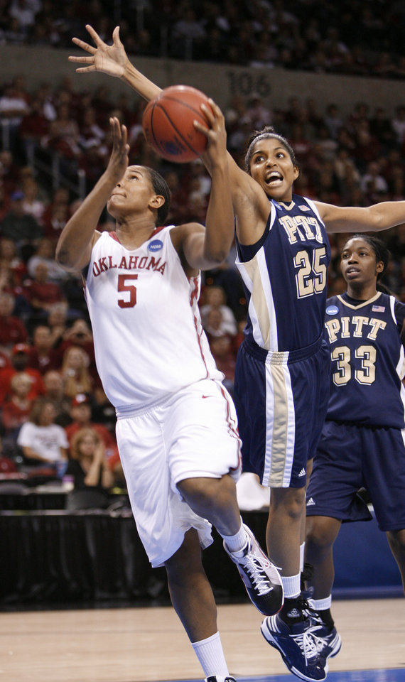 Ashley Paris shoots while guarded by Shayla Scott in the second half of the NCAA women's basketball tournament game between the University of Oklahoma and Pittsburgh at the Ford Center in Oklahoma City, Okla. on Sunday, March 29, 2009. 