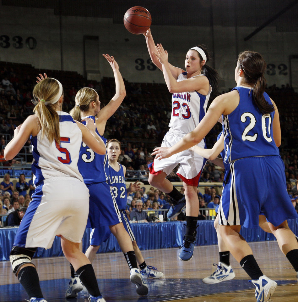 Photo - Hammon's Peyton Walker (23) passes the ball to Chania Walker (5) over Lomega's Hailey Duffy (33) near Taylor Mendell (32) and Marta Stangl (20) during the Class B girls state championship high school basketball game between Hammon and Lomega at State Fair Arena in Oklahoma City, Saturday, March 3, 2012. Lomega won, 49-44. Photo by Nate Billings, The Oklahoman