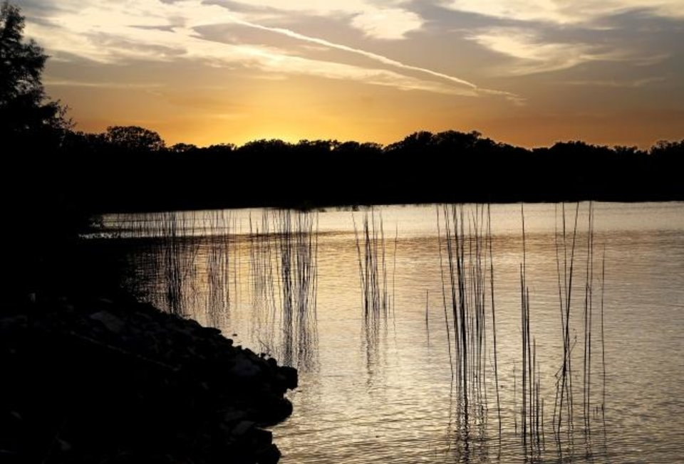 Photo -  A sunset from the cove at the marina at Lake Stanley Draper in 2014 after improvements were completed. [The Oklahoman Archives]
