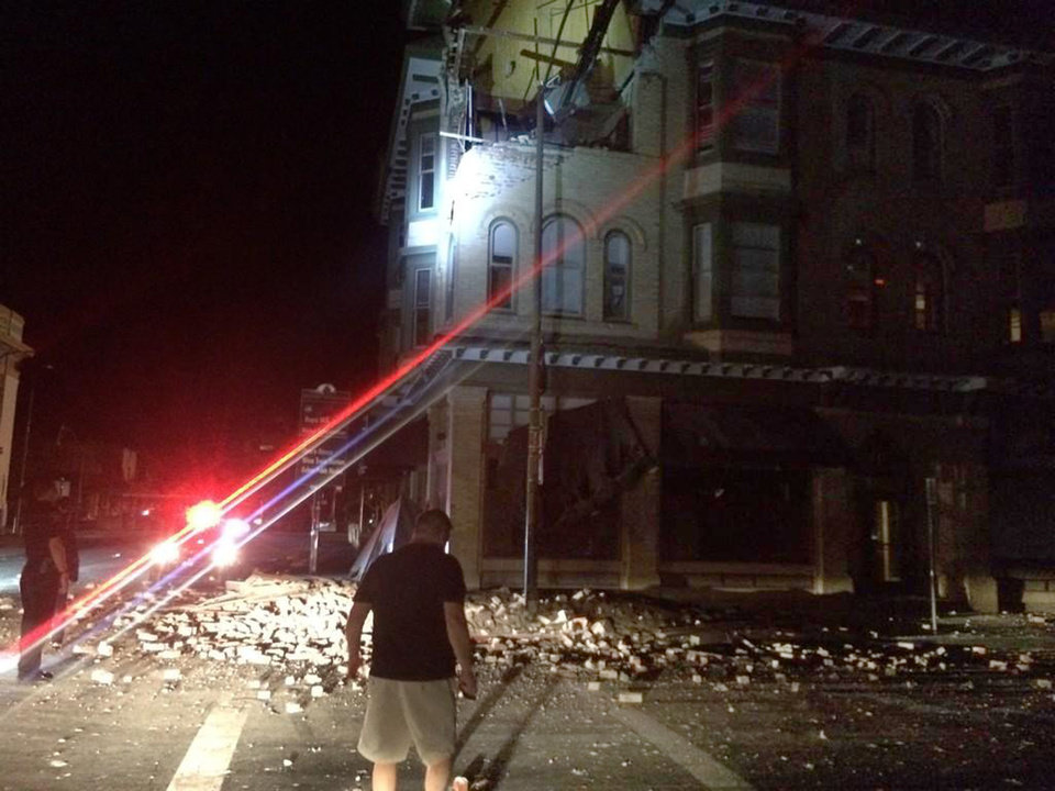Photo - This photo provided by Lyall Davenport shows damage to a building in Napa, Calif. early Sunday, Aug. 24, 2014. Officials say an earthquake with a preliminary magnitude of 6.0 has been reported in California's northern San Francisco Bay area. (AP Photo/Lyall Davenport)