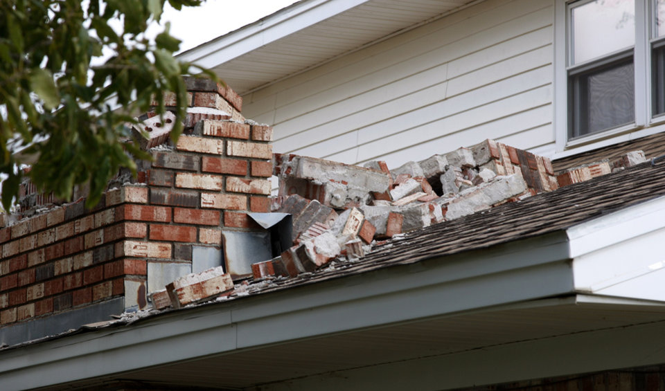 The exterior chimney at the home of Joe and Mary Reneau is pictured in Sparks, Okla., Sunday, Nov. 6, 2011, after it collapsed in Saturday night\'s earthquake. (AP Photo/Sue Ogrocki) ORG XMIT: OKSO107
