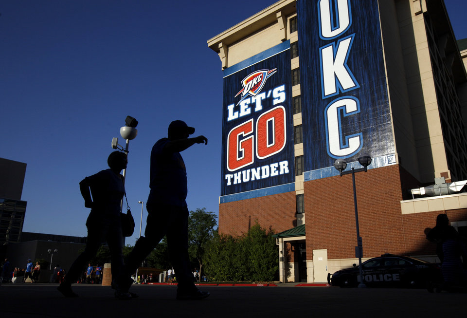 Photo - Fans make their way to the arena before Game 1 of the Western Conference semifinals in the NBA playoffs between the Oklahoma City Thunder and the Los Angeles Clippers at Chesapeake Energy Arena in Oklahoma City, Monday, May 5, 2014. Photo by Bryan Terry, The Oklahoman