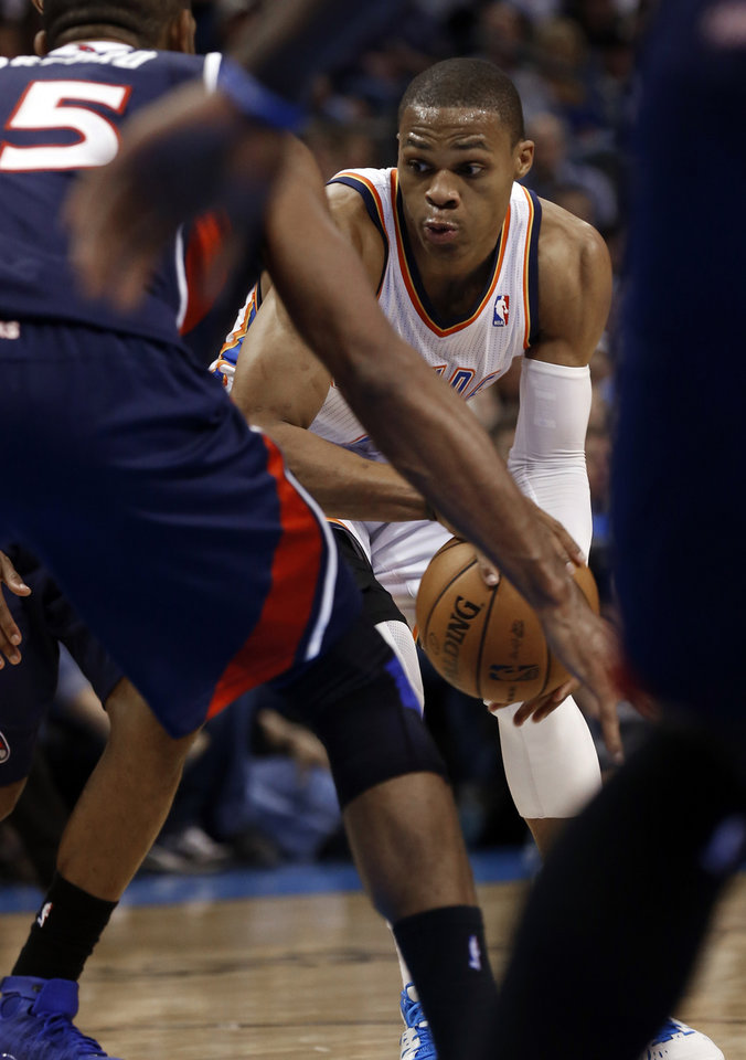 Photo - Oklahoma City Thunder's Russell Westbrook (0) looks for a passing lane as the Oklahoma City Thunder play the Atlanta Hawks in NBA basketball at the Chesapeake Energy Arena in Oklahoma City, on Sunday, Nov. 4, 2012.  Photo by Steve Sisney, The Oklahoman
