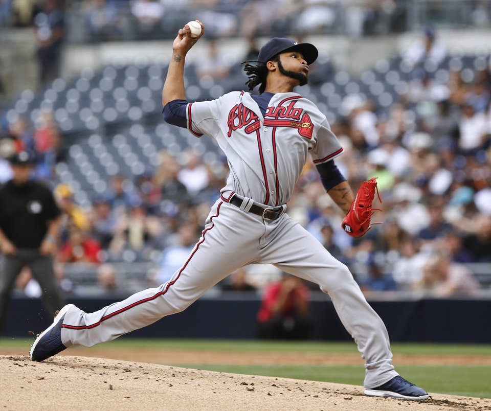 Photo - Atlanta Braves starting pitcher Ervin Santana throws against the San Diego Padres during the first inning of a baseball game Saturday, Aug. 2, 2014, in San Diego. (AP Photo/Don Boomer)