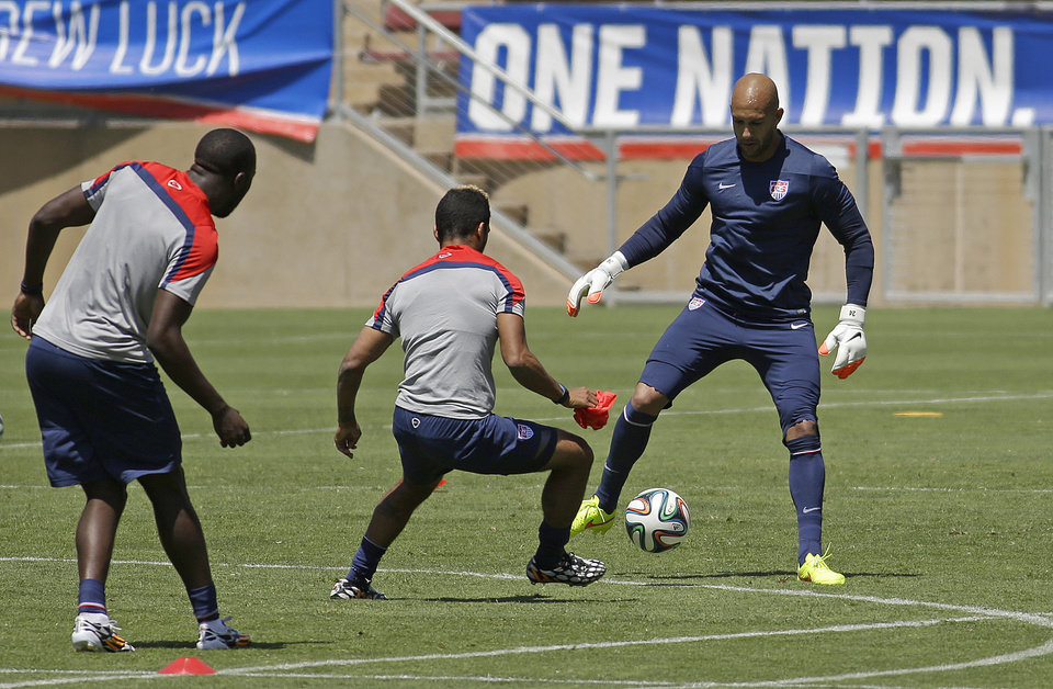 Photo - United States goalie Tim Howard, right, practices during training in preparation for the World Cup soccer tournament on Thursday, May 22, 2014, in Stanford, Calif. (AP Photo/Ben Margot)