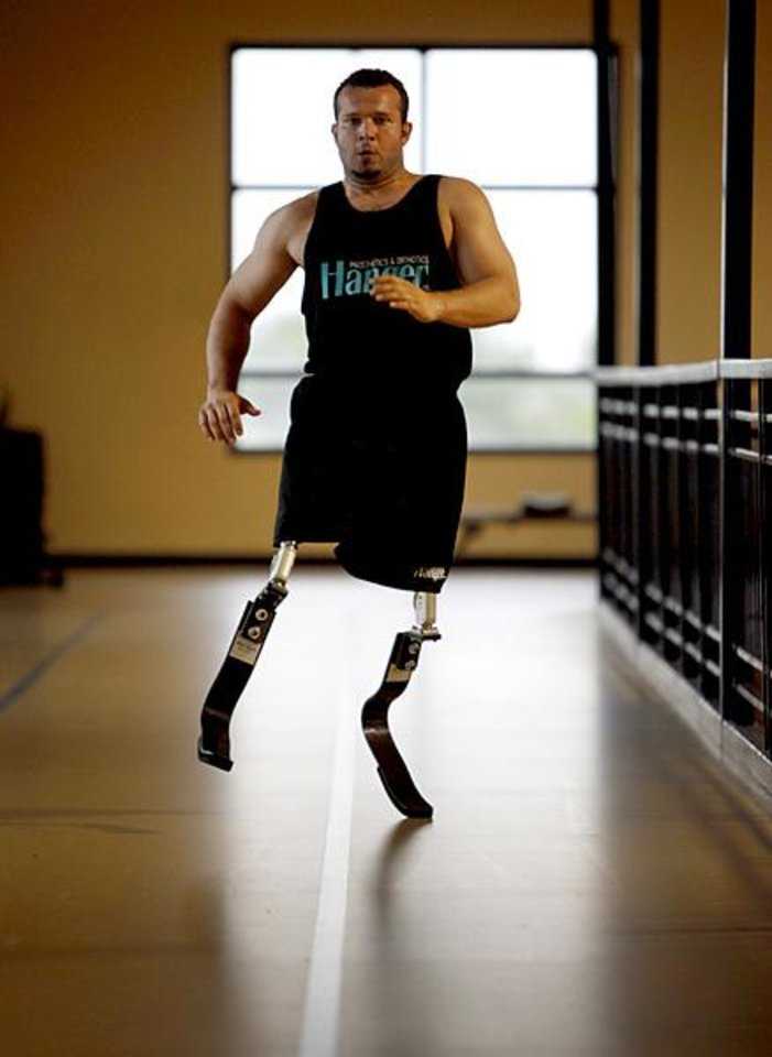 Photo -  Ugur Yumuk of Turkey runs on prosthetic legs at the University of Central Oklahoma Wellness Center on Tuesday, May 24, 2011, in Edmond, Okla.  Yumuk will be running at the Endeavor games for the first time. Photo by Bryan Terry, The Oklahoman