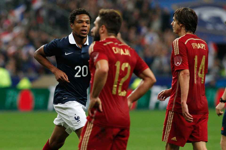 Photo - France's Loic Remy runs after scoring a goal during his international friendly soccer match against Spain at the Stade de France in Saint Denis, outside Paris, Thursday, Sept. 4, 2014. (AP Photo/Thibault Camus)