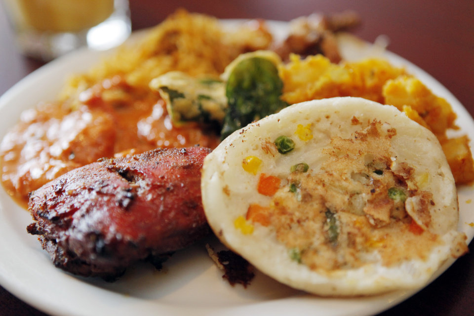 Photo - RESTAURANT: A detailed view of a plate with Uthapam, Tandoori Chicken, Chicken Tikka Masala, Biryani, Tandoori Wings, Potatoes and Spinach Fritters at the KhaZana Indian Grill and Buffet in Oklahoma City, Saturday, February 14, 2009. BY NATE BILLINGS, THE OKLAHOMAN ORG XMIT: KOD