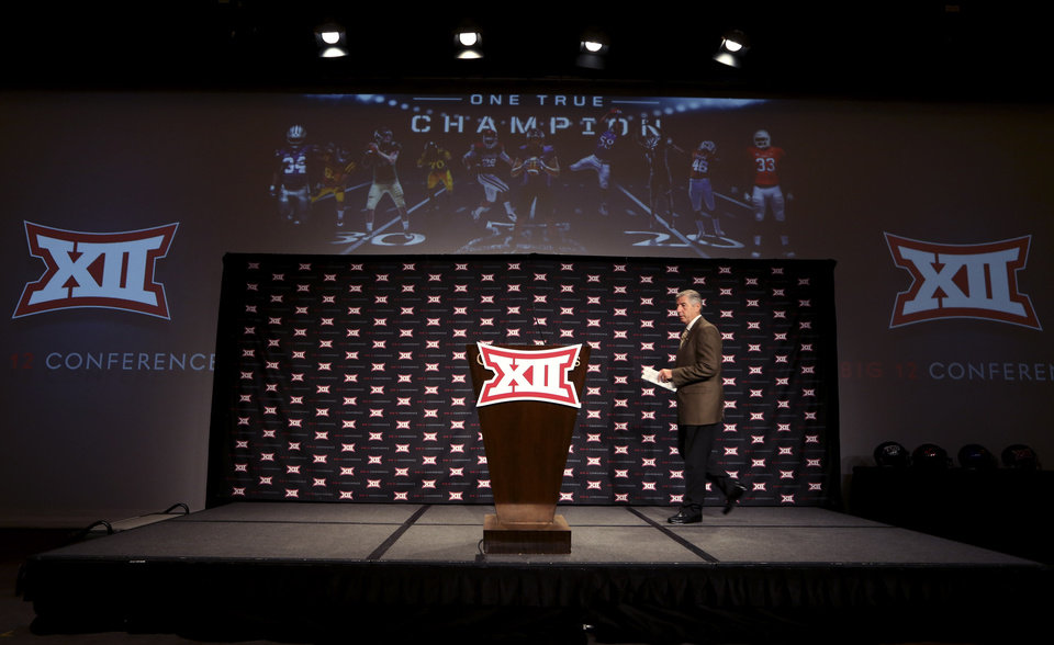 Photo - Big 12 commissioner Bob Bowlsby takes the stage to speak at the opening of the NCAA college Big 12 Conference football media days in  Dallas, Monday, July 21, 2014. (AP Photo/LM Otero)