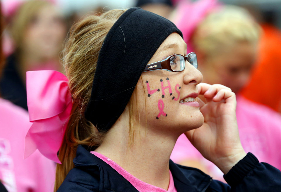 Cheerleader Caitlyn Nere wears a pink ribbon and face paint for Win-Win Cancer Awarness week as the Purcell Dragons play the Lexington Bulldogs in high school football on Friday, Sept. 14, 2012, in Lexington, Okla.  Photo by Steve Sisney, The Oklahoman