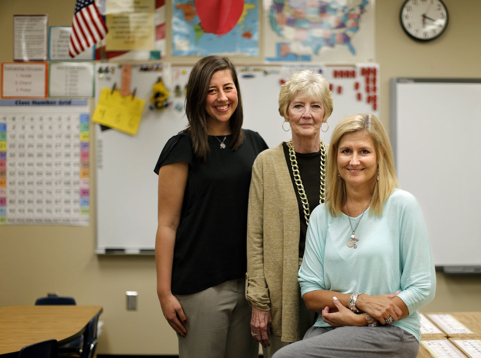 Photo - Taylor Anderson, left, followed in the path of her grandmother Margaret Self and mother, Shelly Anderson,  to teach in Edmond Public Schools. They are pictured in Shelly Anderson's classroom at Northern Hills Elementary in Edmond. Photo by Bryan Terry, The Oklahoman   BRYAN TERRY - THE OKLAHOMAN