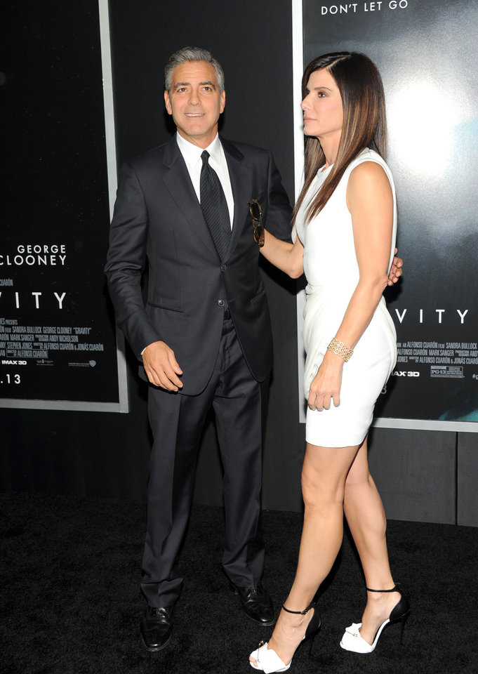 "Photo - Actors George Clooney and Sandra Bullock attend the premiere of ""Gravity"" at the AMC Lincoln Square Theaters on Tuesday, Oct. 1, 2013, in New York. (Photo by Evan Agostini/Invision/AP) ORG XMIT: NYEA109"
