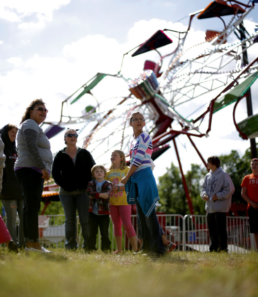 Photo -      A crowd waits for the start of a carnival during the 2012 Guthrie 89er Day Celebration. Photo by Bryan Terry, The Oklahoman Archive   BRYAN TERRY -  THE OKLAHOMAN