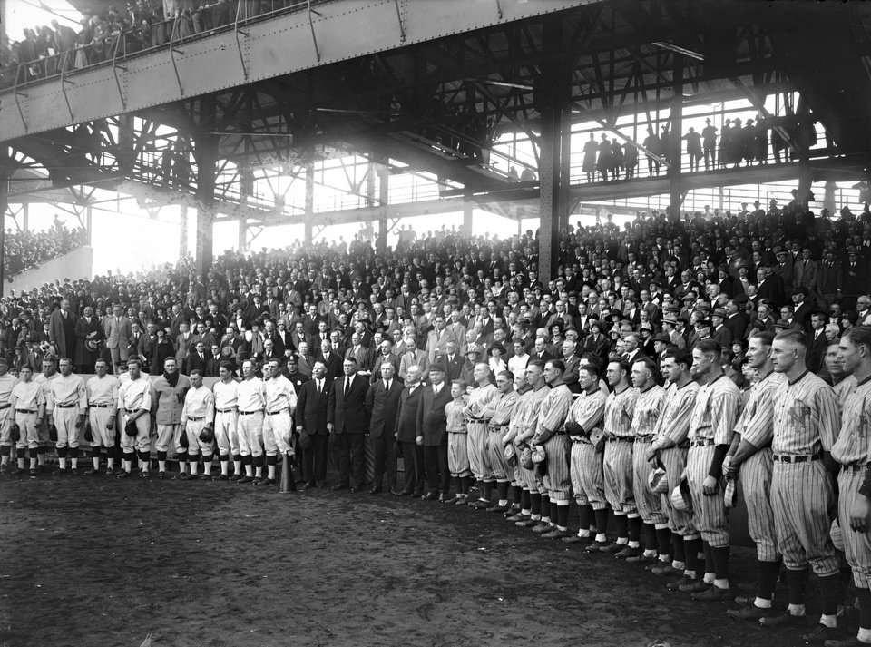 Photo -   In this Oct. 10, 1924 photo, provided by the Library of Congress, Washington Senators and New York Giants managers and players join umpires before the final game of baseball's World Series in Washington. Like this year's Washington Nationals, the 1924 World Series champion Washington Senators generated excitement in a city starved for a baseball winner. The Nats will begin their quest for the city's second championship when the playoffs begin this weekend. (AP Photo/Library of Congress)