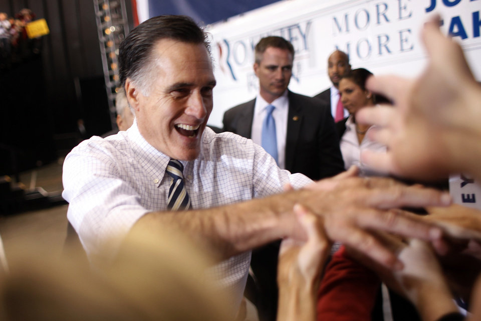 Republican presidential candidate and former Massachusetts Gov. Mitt Romney greets supporters during a campaign rally at the International Exhibition Center in Cleveland, Sunday Nov. 4, 2012. (AP Photo/Jerome Delay)