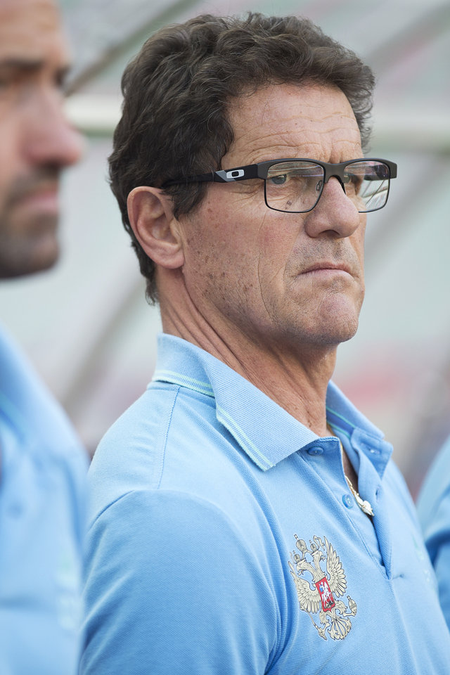 Photo - Russian national soccer team head coach Fabio Capello looks on before a friendly soccer match against Morocco in Moscow, Russia, Friday, June 6, 2014. Russia won 2-0. This is the last friendly match before Russia team leaving for Brazil to compete in the World Cup. (AP Photo/Pavel Golovkin)