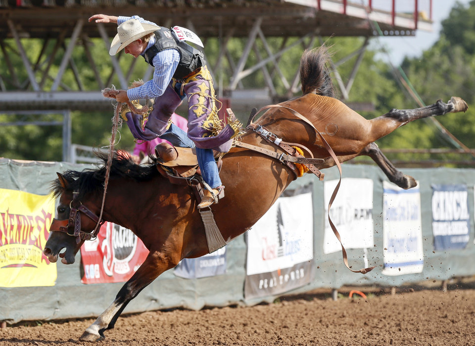Photo - Cauy Pennington of Kiowa, Colorado, competes in saddle bronc during the International Finals Youth Rodeo at the Heart of Oklahoma Exposition Center in Shawnee, Okla., Thursday morning, July 11, 2019. [Nate Billings/The Oklahoman]