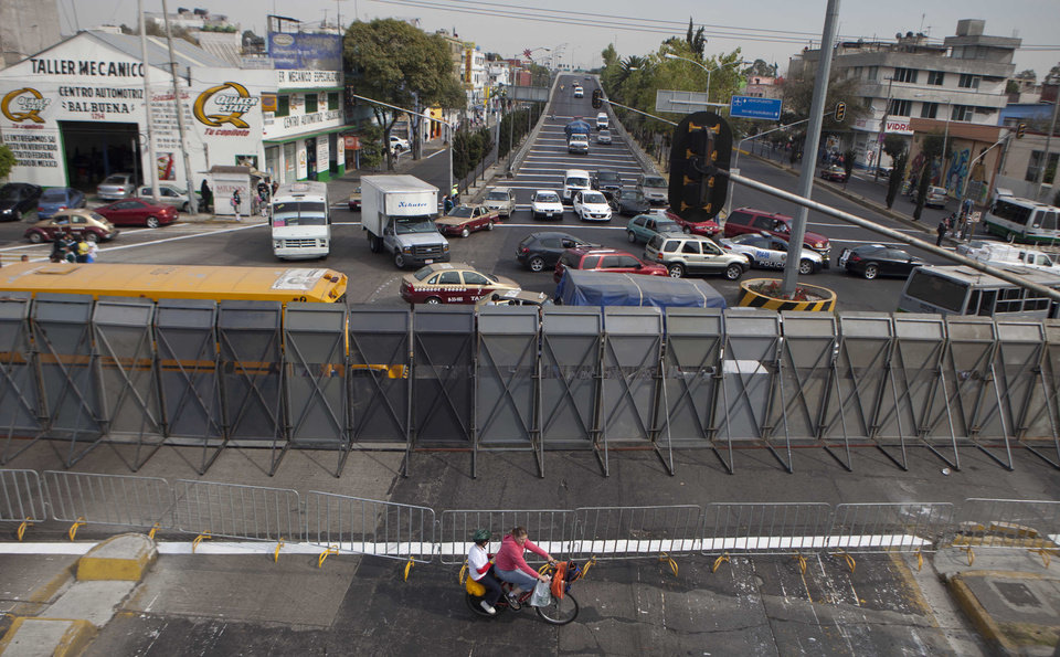 The street where Mexico\'s Congress is located is shown blocked by a metal barricade in Mexico City, Monday, Nov. 26, 2012. Police heightened security around the building where Mexico\'s President-elect Enrique Pena Nieto, of the Institutional Revolutionary Party (PRI) will be sworn-in on Dec. 1. (AP Photo/Eduardo Verdugo)