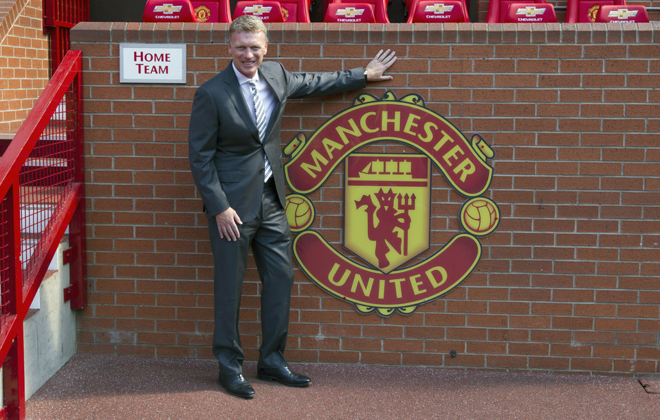 Photo - FILE - In this Friday July 5, 2013 file photo Manchester United's new manager David Moyes poses for pictures before a press conference at Old Trafford Stadium, Manchester, England. Manchester United says manager David Moyes has left the Premier League club after less than a year in charge, amid heavy speculation he was about to be fired. United released a brief statement in its website Tuesday, saying the club
