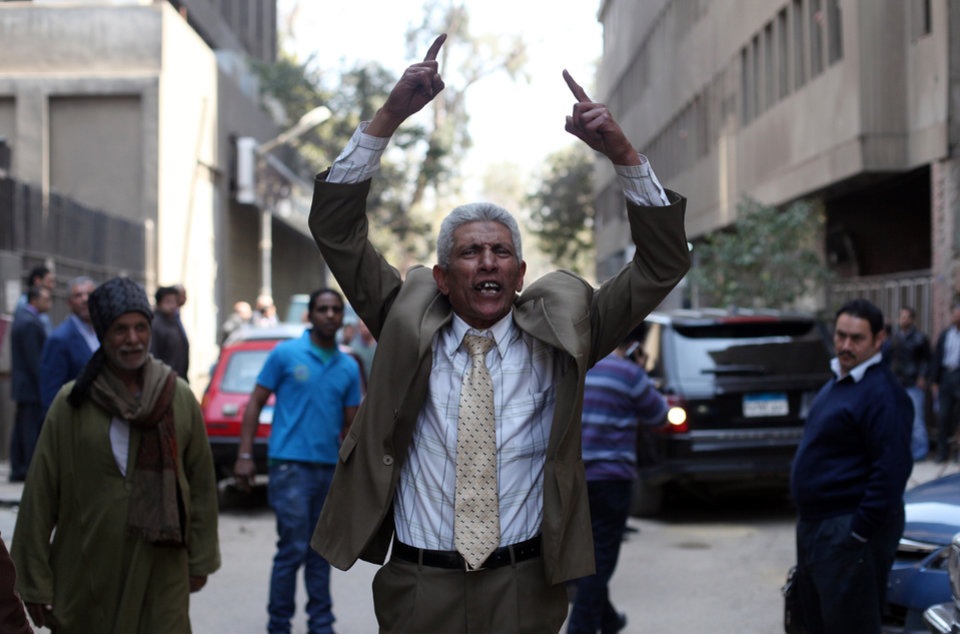A man reacts after Egyptian police arrest Ahmed Qaddaf al-Dam, cousin of Libya�s former dictator Moammar Gadhafi, not pictured, after being arrested in Cairo, Egypt, Tuesday, March 19. 2013. Egyptian security forces arrested a cousin of Libya�s former dictator Moammar Gadhafi on Tuesday following an hours-long siege of his home in central Cairo, a security official and witnesses said. (AP Photo/Khalil Hamra)
