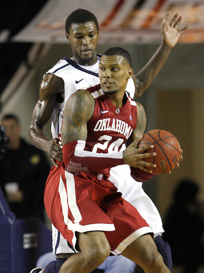 Oklahoma's Romero Osby, front,  heads for the basket under pressure from Oral Roberts' Steven Roundtree, top, during a basketball game at Oral Roberts University in Tulsa, Okla. on Wednesday, Nov. 28, 2012. (AP Photo/Tulsa World, Matt Barnard) ORG XMIT: OKTUL103
