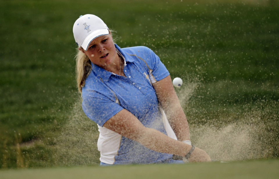 Photo - Europe's Caroline Hedwall, from Sweden, hits from a sand trap on the eighth hole during her singles match against United States' Michelle Wie at the Solheim Cup golf tournament on Sunday, Aug. 18, 2013, in Parker, Colo. (AP Photo/Chris Carlson)