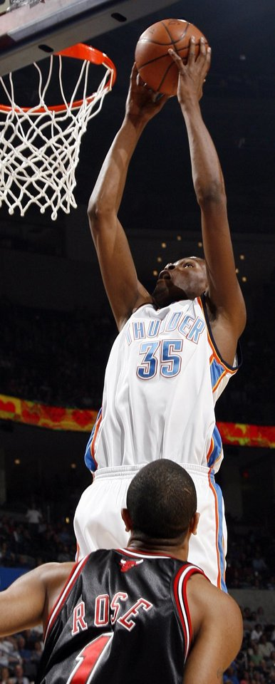Oklahoma City's Kevin Durant (35) shoots over Chicago's Derrick Rose (1) in the first half of the NBA basketball game between the Chicago Bulls and the Oklahoma City Thunder at the Ford Center in Oklahoma City, Wednesday, March 18, 2009. PHOTO BY NATE BILLINGS, THE OKLAHOMAN