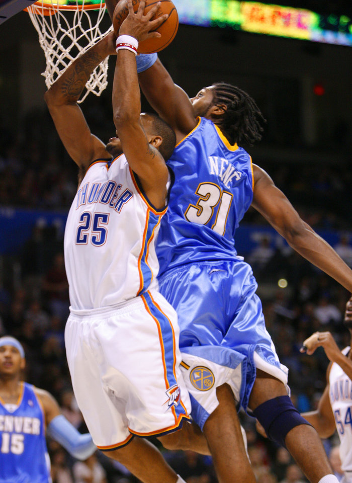 Earl Watson tries to shoot under the block of Nene in the second half as the Oklahoma City Thunder play the Denver Nuggets at the Ford Center in Oklahoma City, Okla. on Friday, January 2, 2009. Photo by Steve Sisney/The Oklahoman