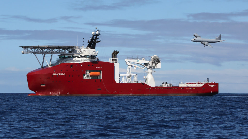 Photo - In this April 9, 2014 photo provided by the Australian Defense Force, a Royal Australian Air Force AP-3C Orion flies past Australian Defense vessel Ocean Shield on a mission to drop sonar buoys to assist in the acoustic search of the missing Malaysia Airlines Flight 370 in the southern Indian Ocean. The ship searching for the missing Malaysian jet has detected two more underwater signals that may be emanating from the aircraft's black boxes, and the Australian official in charge of the search expressed hope Wednesday that the plane's wreckage will soon be found.   (AP Photo/Australian Defense Force, LSIS Bradley Darvill) EDITORIAL USE ONLY