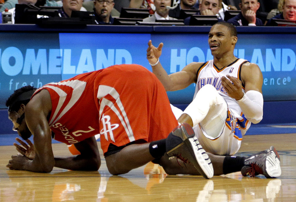 Photo - Oklahoma City's Russell Westbrook (0) reacts after a foul from Houston's Patrick Beverley (2) during the NBA game between the Oklahoma City Thunder and Houston Rockets at the  Chesapeake Energy Arena  in Oklahoma City, Okla., Tuesday, March 11, 2014. PHOTO BY SARAH PHIPPS, The Oklahoman