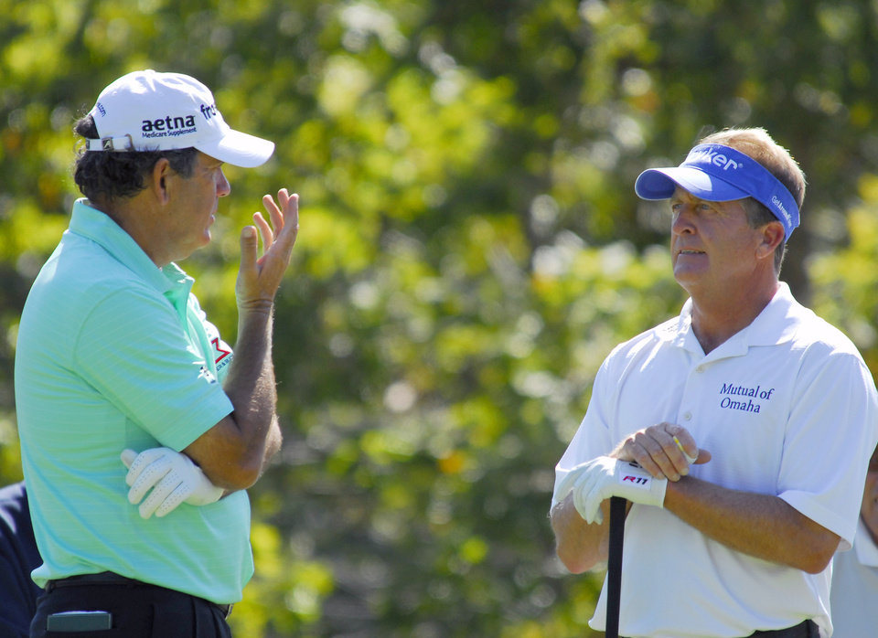 Photo -   David Frost, left, and Fred Funk talk before teeing off on the seventh hole during the second round of the Greater Hickory Classic Champions Tour golf tournament at Rock Barn in Conover, N.C., Saturday, Oct. 13, 2012 (AP Photo/Robert Reed)