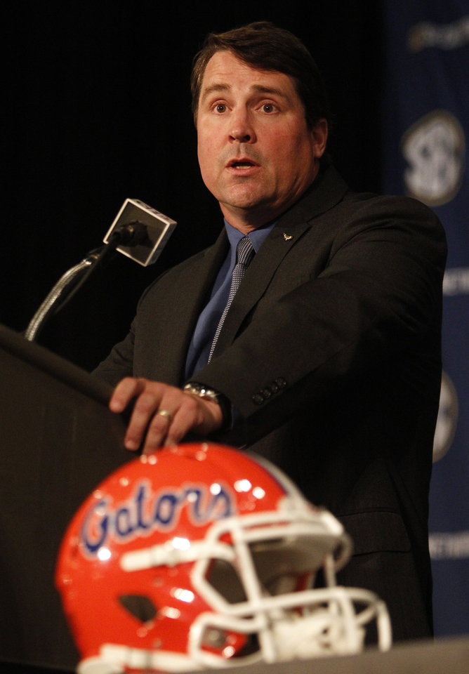 Photo - Florida Coach Will Muschamp speaks to media at SEC media days on Monday, July 14, 2014, in Hoover, Ala. (AP Photo/Butch Dill)
